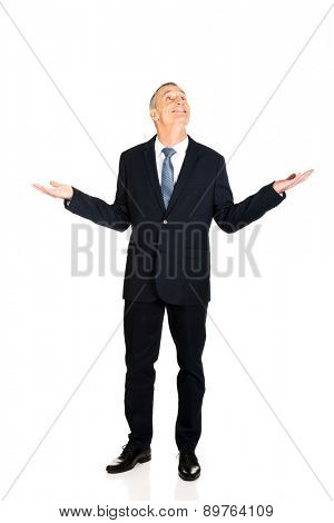 Full length businessman with hands open gesture.