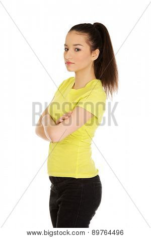 Friendly smiling young student woman with folded arms.