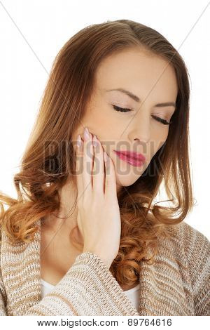 Woman suffering from tooth ache.
