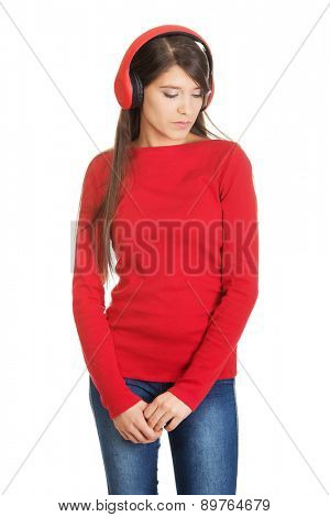 Young woman with headphones listening music.
