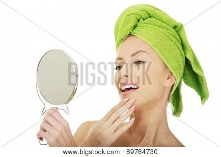 Beautiful spa woman with a mirror.