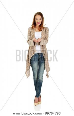 Beautiful casual woman showing empty hands.