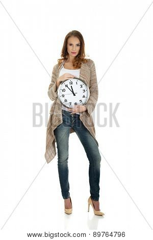 Beautiful happy woman with clock.