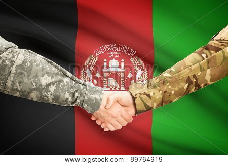 Men In Uniform Shaking Hands With Flag On Background - Afghanistan