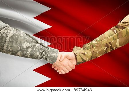 Men In Uniform Shaking Hands With Flag On Background - Bahrain