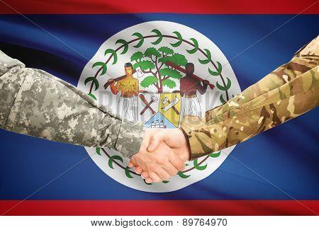 Men In Uniform Shaking Hands With Flag On Background - Belize