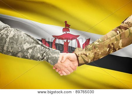 Men In Uniform Shaking Hands With Flag On Background - Brunei
