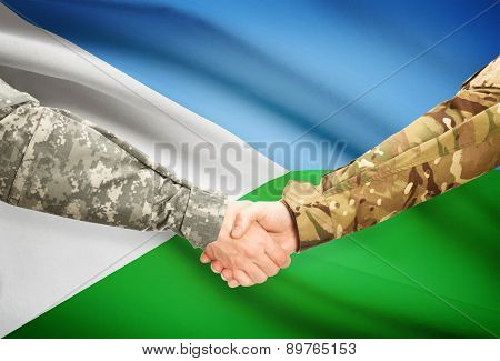 Men In Uniform Shaking Hands With Flag On Background - Djibouti