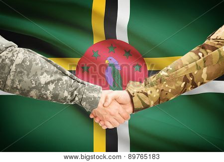 Men In Uniform Shaking Hands With Flag On Background - Dominica