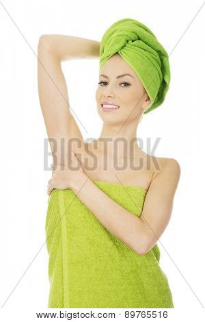 Beautiful woman with towel wrapped on head.