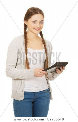Happy teen woman hold digital calculator.