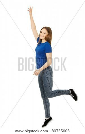 Teen woman with hand up holding copy space.