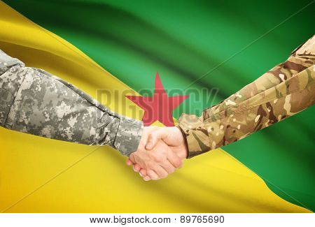 Men In Uniform Shaking Hands With Flag On Background - French Guiana