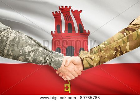Men In Uniform Shaking Hands With Flag On Background - Gibraltar