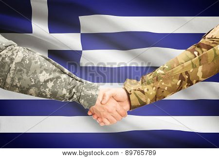 Men In Uniform Shaking Hands With Flag On Background - Greece
