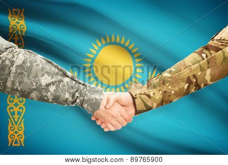 Men In Uniform Shaking Hands With Flag On Background - Kazakhstan