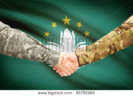 Men In Uniform Shaking Hands With Flag On Background - Macau