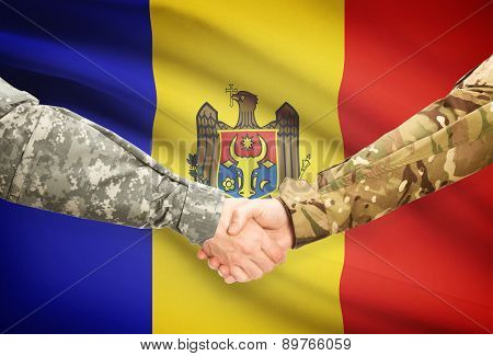 Men In Uniform Shaking Hands With Flag On Background - Moldova