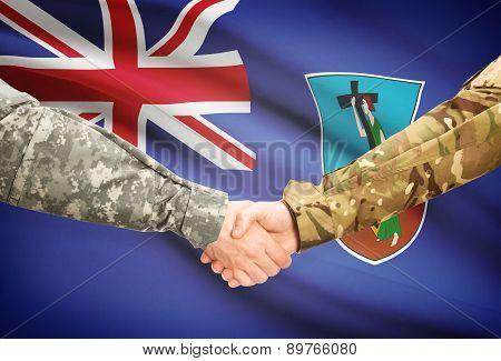 Men In Uniform Shaking Hands With Flag On Background - Montserrat