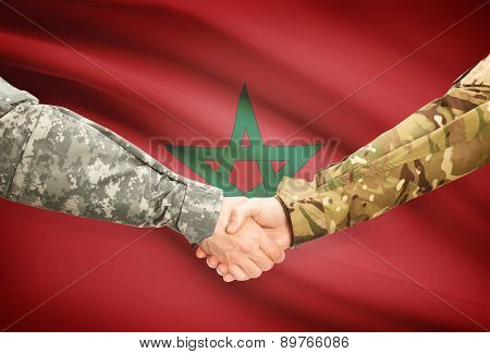 Men In Uniform Shaking Hands With Flag On Background - Morocco