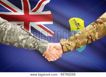 Men In Uniform Shaking Hands With Flag On Background - Saint Helena