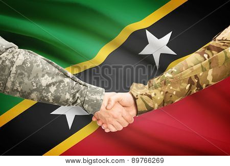 Men In Uniform Shaking Hands With Flag On Background - Saint Kitts And Nevis