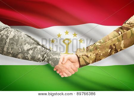 Men In Uniform Shaking Hands With Flag On Background - Tajikistan