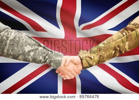 Men In Uniform Shaking Hands With Flag On Background - United Kingdom