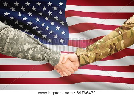 Men In Uniform Shaking Hands With Flag On Background - United States