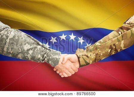 Men In Uniform Shaking Hands With Flag On Background - Venezuela