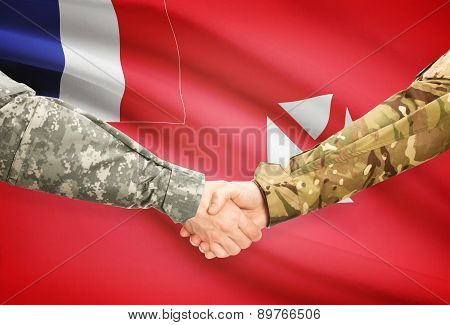Men In Uniform Shaking Hands With Flag On Background - Wallis And Futuna