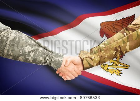 Men In Uniform Shaking Hands With Flag On Background - American Samoa