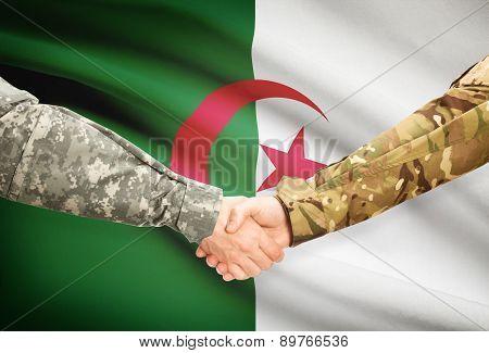 Men In Uniform Shaking Hands With Flag On Background - Algeria