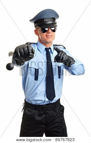Policeman shows with nightstick