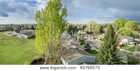 FORT COLLINS, CO, USA - APRIL 28, 2015: Aerial panorama of Fort Collins, a typical residential neighborhood along Front Range of Rocky Mountains in Colorado,  early spring with fresh green colors