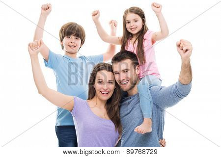 Excited family with arms raised