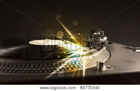 Music player playing vinyl with glow lines comming from the needle concept on background