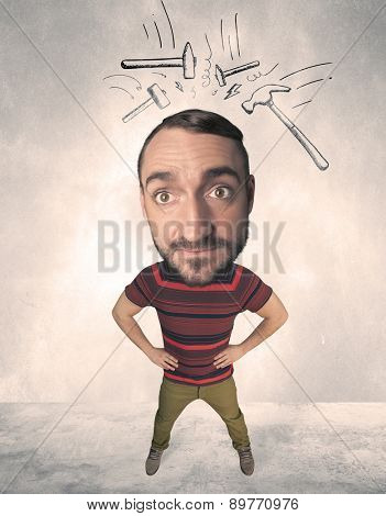 Funny person with big head and drawn punching hammers over it