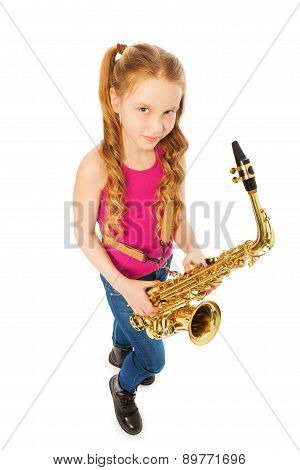 Tope view of smiling girl holding alto saxophone
