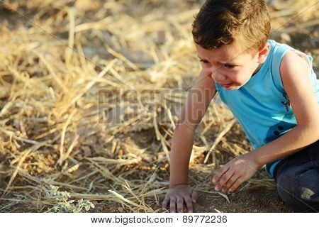 Kid crying on field