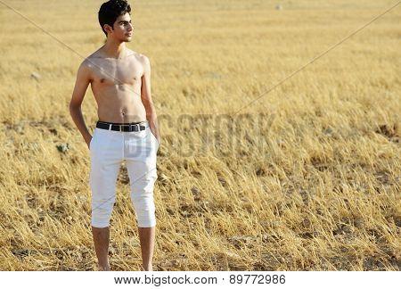 Teenage boy in nature half naked