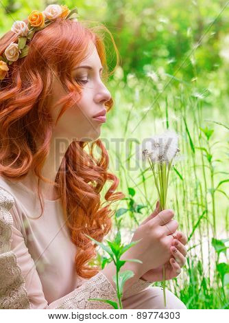 Portrait of nice dreamy woman on fresh green field with dandelion flower bouquet, having fun in the park, enjoy spring nature with closed eyes