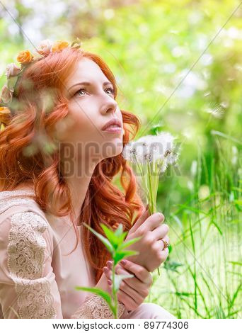 Portrait of nice dreamy woman on fresh green field with dandelion flower bouquet, having fun in spring park, enjoy nature beauty
