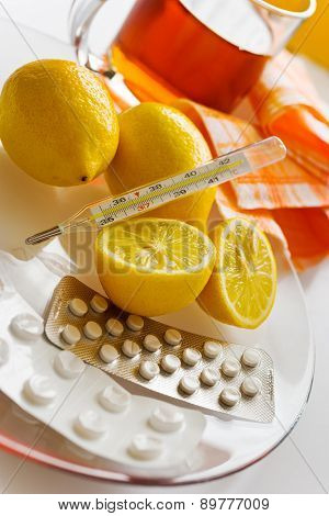 Tea With Lemons And Flu Pills With Thermometer - Grippe Remedy