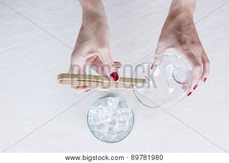 Filling A Balloon Glass With Ice.