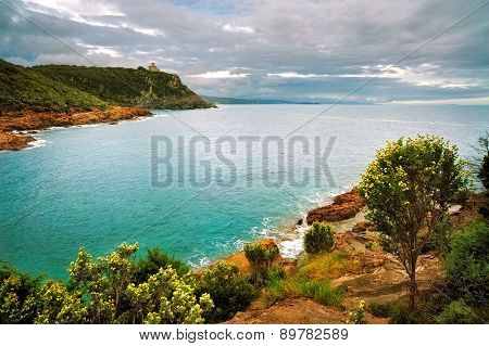 Cliff Rock And Sea On Sunset. Leghorn Coast, Tuscany Riviera, Italy