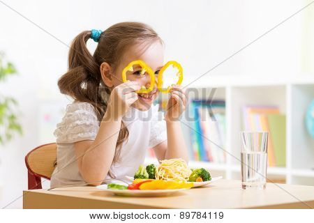 child eating in kindergarten