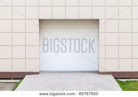 Modern Storage Building Wall With Closed White Gate