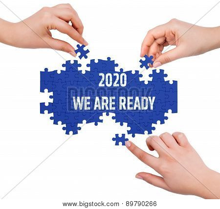 Hands With Puzzle Making 2020 We Are Ready Word  Isolated On White