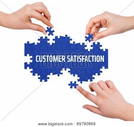 Hands With Puzzle Making Customer Satisfaction Word  Isolated On White